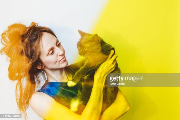 woman holding cat, cat lady, crazy cat lady, cat love, pet owner - soltanto un animale foto e immagini stock