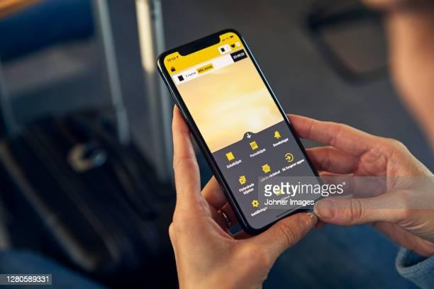 woman holding cell phone - human body part stockfoto's en -beelden
