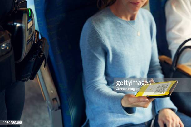 woman holding cell phone with e-ticket - human body part stock pictures, royalty-free photos & images