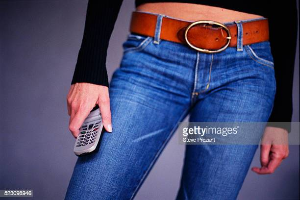 woman holding cellular telephone - belt stock pictures, royalty-free photos & images