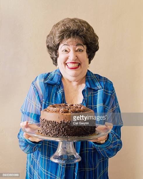 woman holding chocolate cake - fat woman funny stock photos and pictures