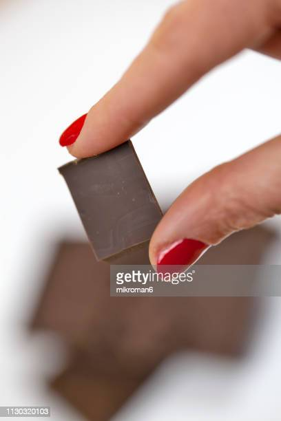 woman holding chocolate chunks - chocolate stock pictures, royalty-free photos & images