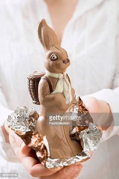 Woman holding chocolate Easter bunny