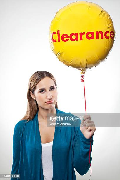 Woman holding clearance balloon
