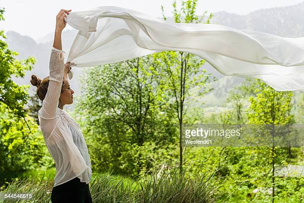 Woman holding cloth outdoors