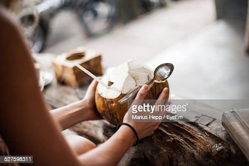 Woman Holding Coconut Drink