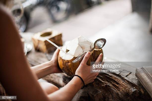 woman holding coconut drink - coconut water stock pictures, royalty-free photos & images