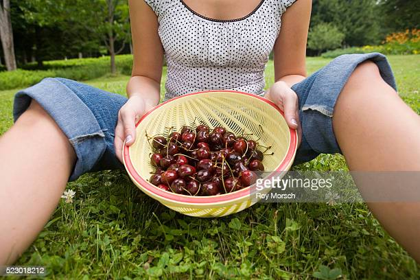 Woman Holding Colander with Fresh Cherries