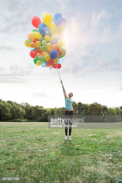 Woman holding colorful balloons