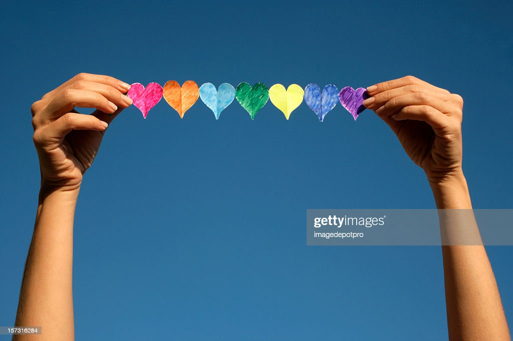 woman holding colorful hearts : Stock Photo