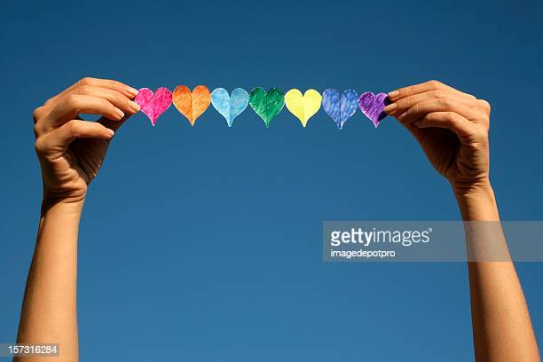 woman holding colorful hearts