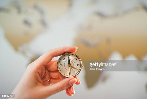Woman holding compass, close-up