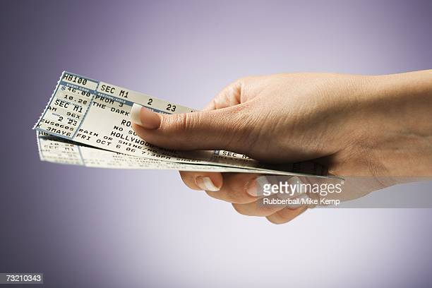 woman holding concert tickets - ticket stock pictures, royalty-free photos & images