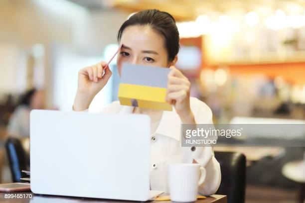Passbook stock photos and pictures getty images woman holding credit card and account passbook colourmoves