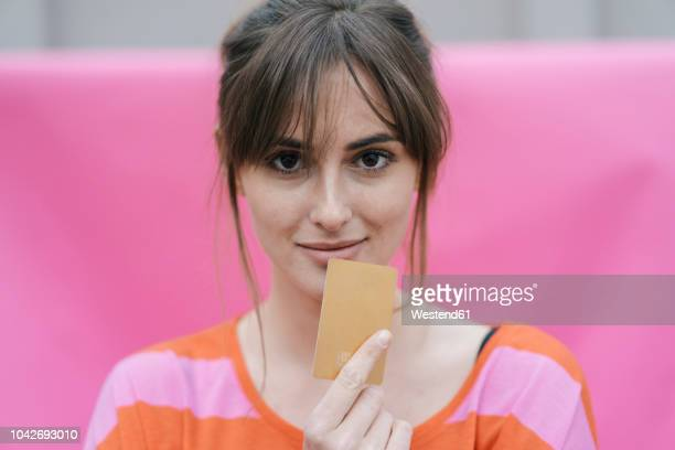 woman holding credit card - credit card stock pictures, royalty-free photos & images