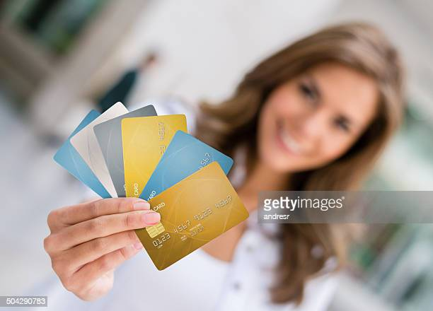 woman holding credit cards - handful stock pictures, royalty-free photos & images