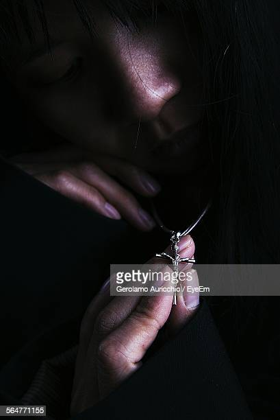 Woman Holding Cross Necklace