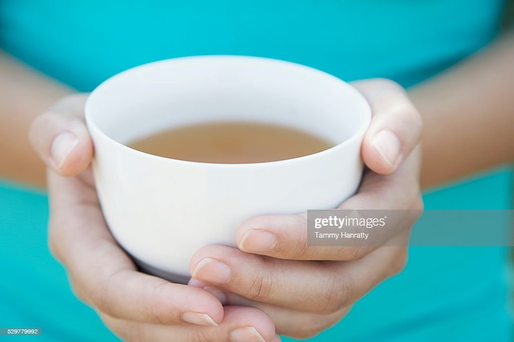 Woman holding cup of tea : Stock Photo