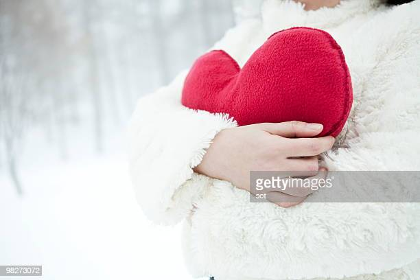 woman holding cushion of red heart,close up - cushion stock photos and pictures