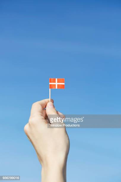 Woman holding Danish flag in hand