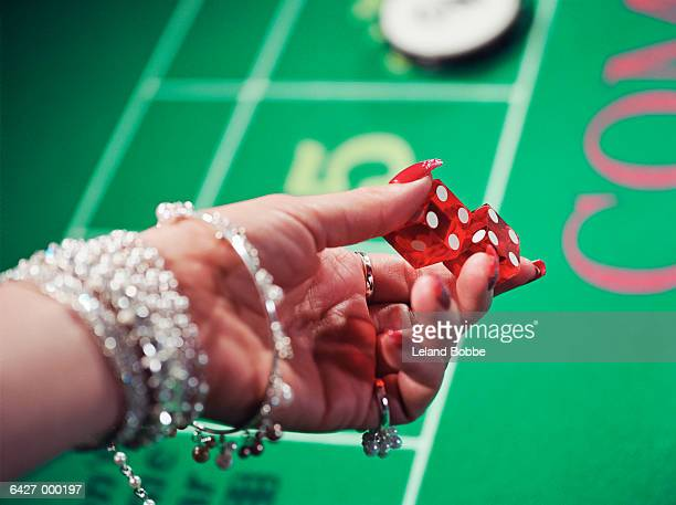 Woman Holding Dice