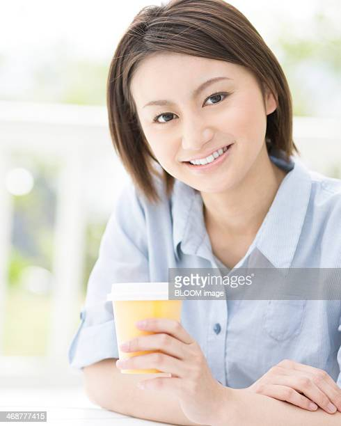 Woman Holding Disposable Coffee Cup