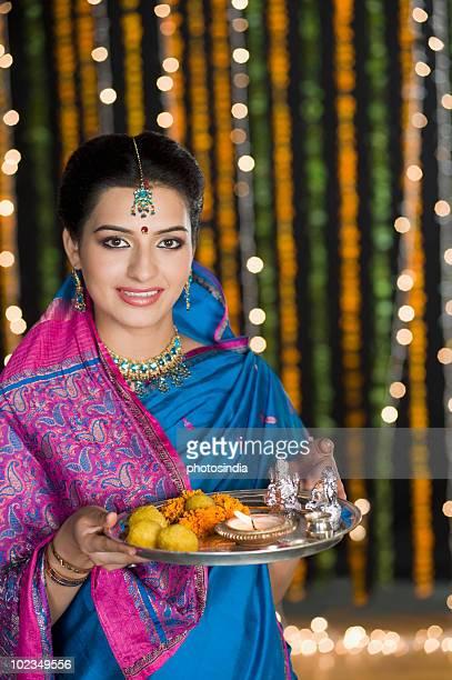 Woman holding Diwali thali