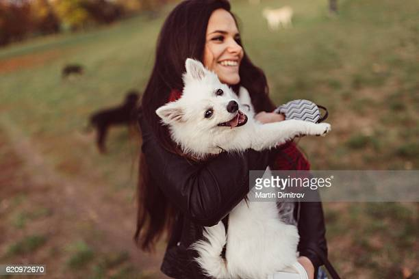 Woman holding dog in hands