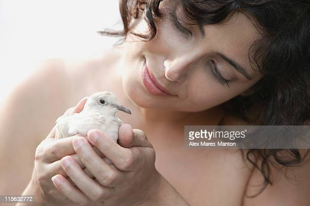 Woman holding dove in cupped hands
