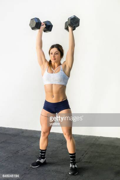 Woman holding dumbbells