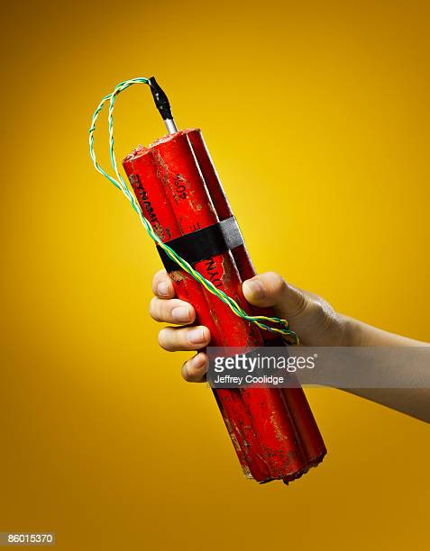 woman holding dynamite - dynamite stock photos and pictures