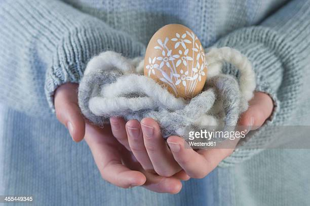 woman holding easter egg - adults only stock pictures, royalty-free photos & images