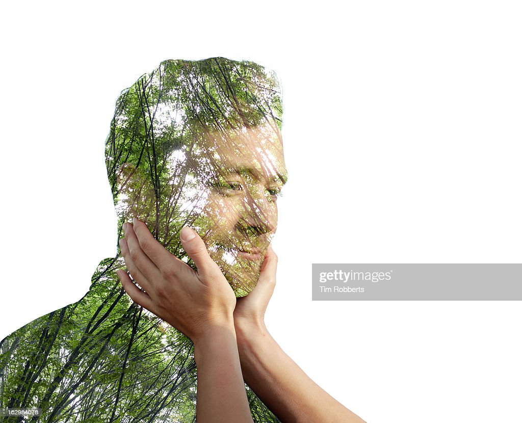 Woman holding eco man's face. : Stock Photo