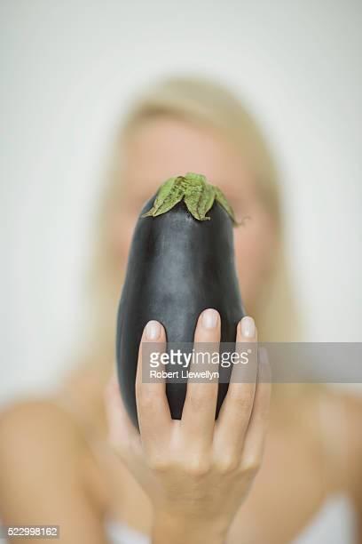 Woman Holding Eggplant