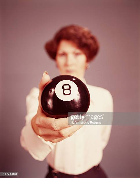 Woman holding eight ball, portrait. (Photo by H. Armstrong Roberts/Retrofile/Getty Images)
