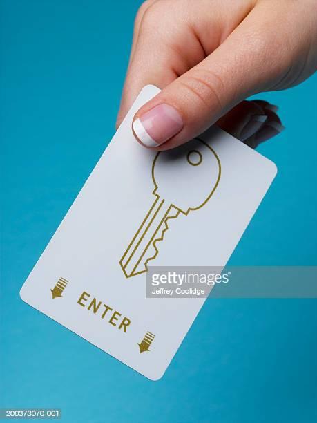Woman holding electronic key, close-up