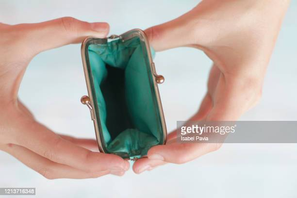 woman holding empty purse - evening bag stock pictures, royalty-free photos & images
