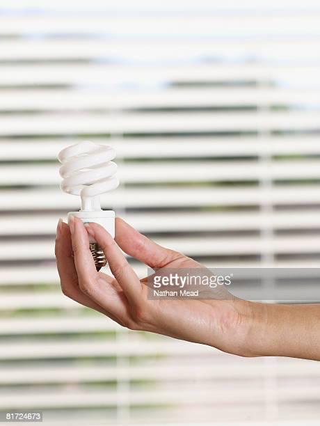 Woman holding environmentally sound lightbulb