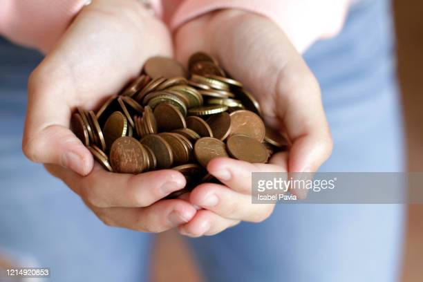 woman holding euro cent coins on hands - female mound stock pictures, royalty-free photos & images