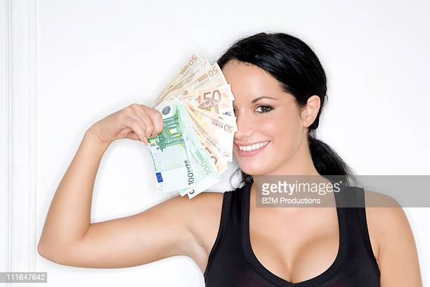 Woman holding Euro notes, Portrait