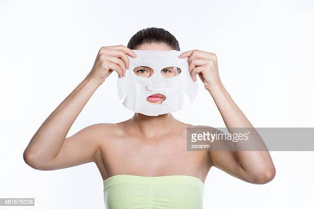 Woman holding facial mask