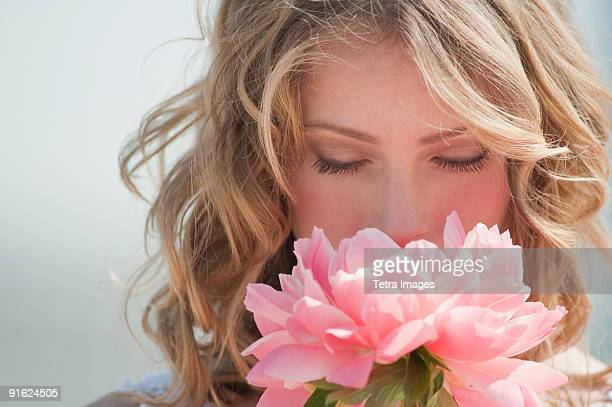A woman holding flowers