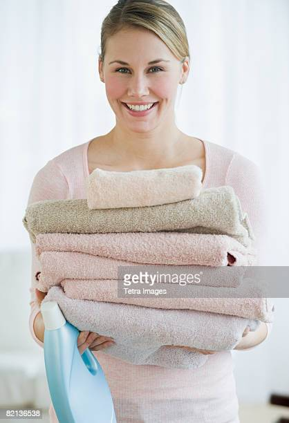 Woman holding folded towels