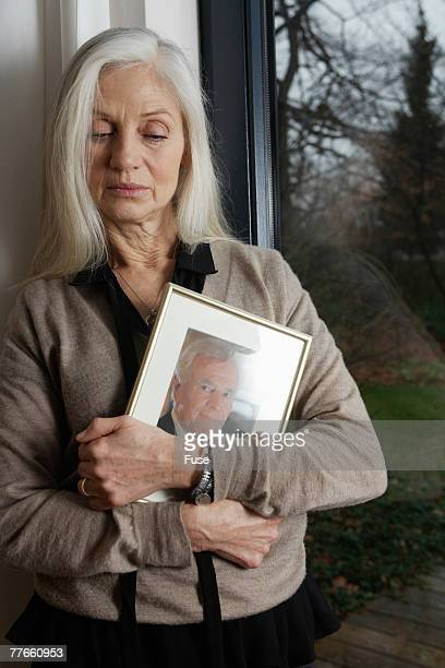 Woman Holding Framed Photograph
