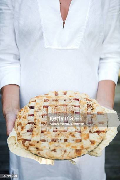 woman holding fresh baked pie