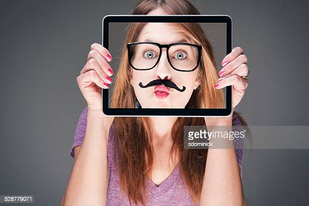 Woman Holding Funny Photo Over Face