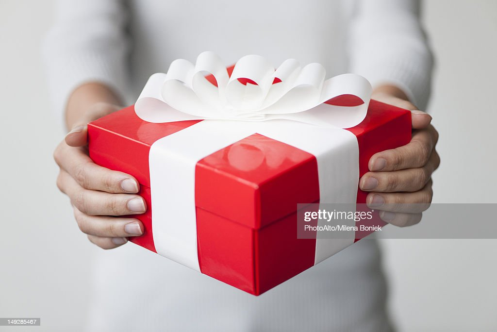 Woman holding gift box, cropped : Stock Photo