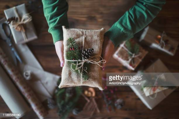 woman holding gift - environmental issues stock pictures, royalty-free photos & images
