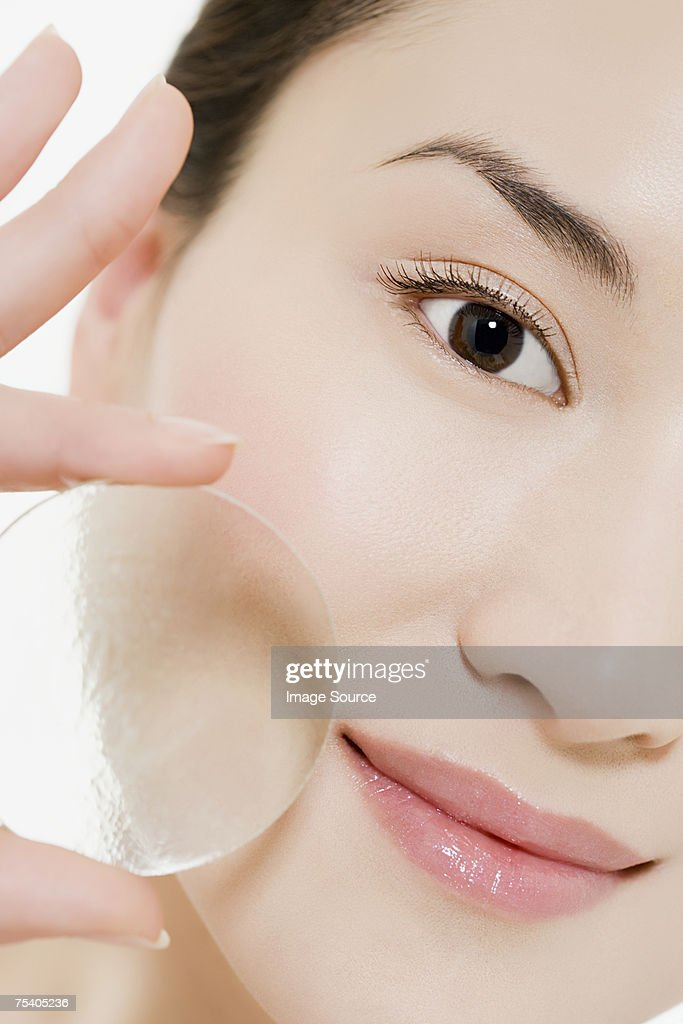 Woman holding glass circle : Stock Photo