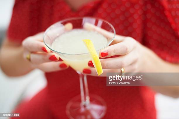 Woman holding glass of cocktail